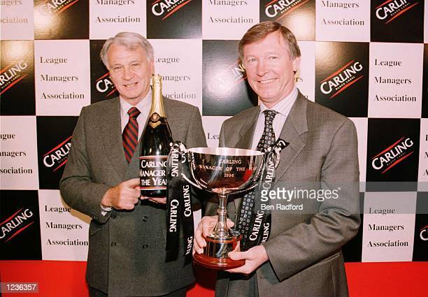 Guest of honour Bobby Robson presents Manager Alex Ferguson of Manchester United with the Carling Manager of The Year award during the league...