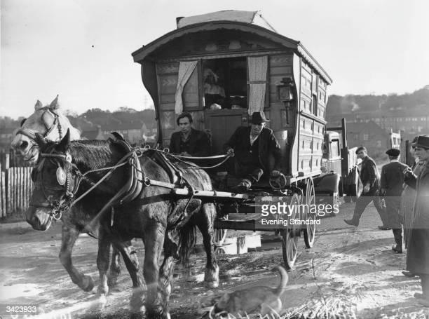 Gypsies driving their horsedrawn caravan