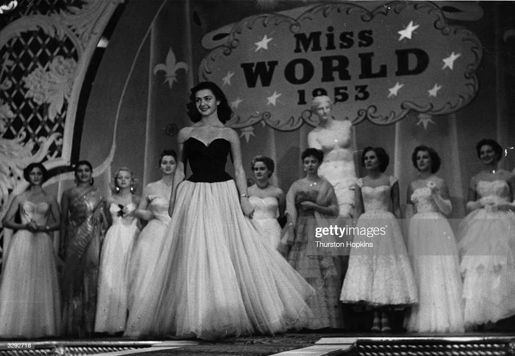Beauty queens from fifty countries compete for the title of 'Miss World' sponsored by Mecca Dancing Ltd. Centre stage is Denise Perrier, Miss France, the winner of the title. Original Publication: Picture Post - 6785 - The Beauty Contest Business - pub. 1953