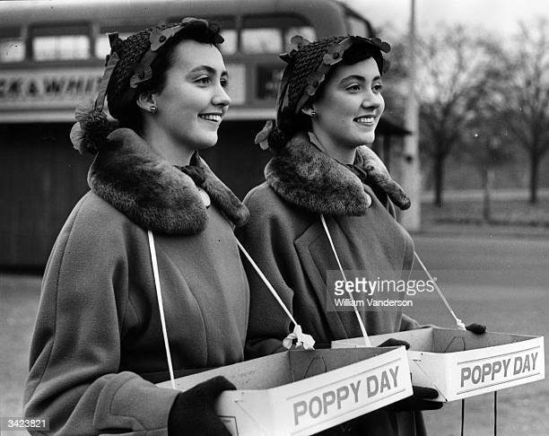 Twin sisters Pamela and Pauline Chamberlain selling Remembrance Day poppies at Leytonstone London