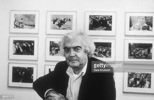 Portrait of Hungarianborn photographer author and editor Cornell Capa and brother of photographer Robert Capa posing in front of a photography...