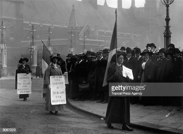 Suffragettes parade in front of the House of Commons as parliament reassembles