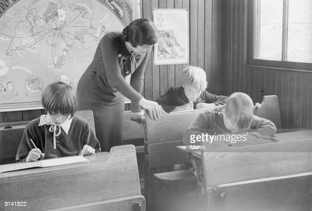 Schoolteacher Miss Williams teaching in the smallest school in Britain at Tweedhope Foot in Tweedsmuir 9 year old Bobby and his 10 year old sister...