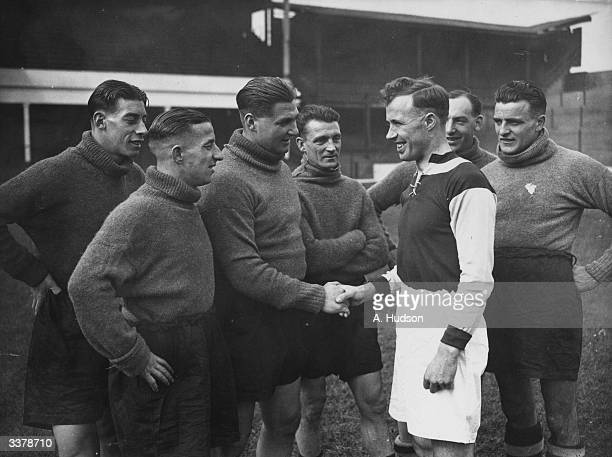 West Ham United captain Jim Barrett leads his team in welcoming David Corbett, the latest arrival at Upton Park from Dundee United.