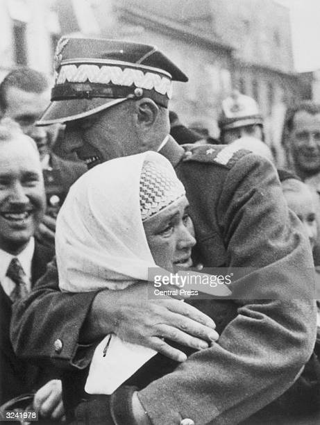 Polish general Wladyslaw Bortnowski embraces an ethnic Polish woman in the Teschen district of Czechoslovakia The region was ceded to Poland under...