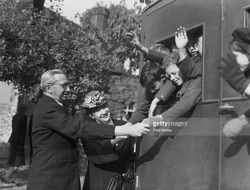 A group of orphaned children from the Dr Barnardo's Garden City, Woodford Bridge, Essex, en route to a new life in Australia being seen off by the deputy High Commissioner for Australia, Mr Norman Mighell.