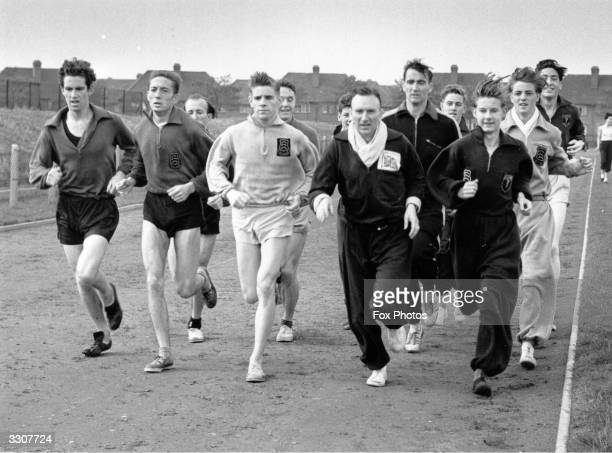 Athletics coach Jim Peters former Olympic marathon runner takes members of the Essex Beagles on a training run at Mayesbrook Park Athletic Ground...