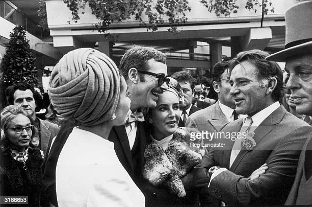 From left to right opera singer Maria Callas with actors Peter O'Toole Elizabeth Taylor and Richard Burton at a race meeting in Longchamp Paris