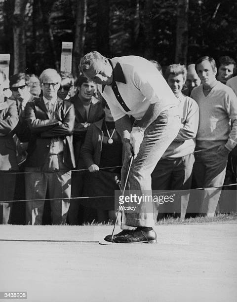 American golfer Arnold Palmer takes a putt in a match against Bob Charles during the Piccadilly World Match Play Championship at Wentworth.