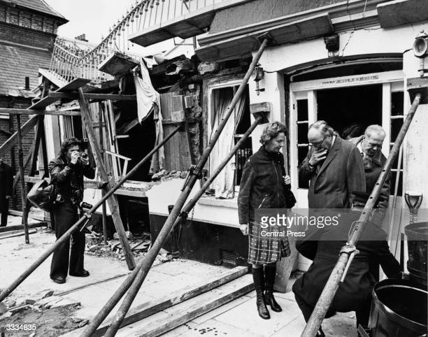 Home secretary Roy Jenkins leaving the wrecked Horse and Groom public house in Guildford two days after an IRA bomb exploded killing five people and...