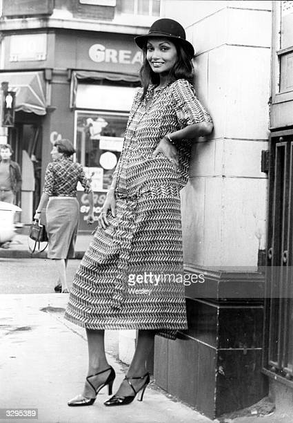 Model Shakira, the wife of Michael Caine, in a cotton voile dress with a fish design. She is launching her collection in the West End of London with...