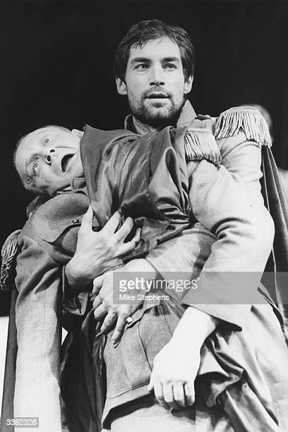 Julius Caesar slumps dying in the arms of Antony during a performance of 'Shakespeare's Rome' at the Mermaid Theatre London