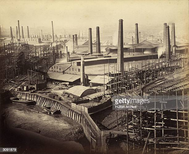 A factory on the dockside at Canning Town London and nearby a ship under construction