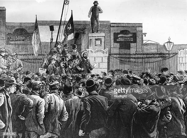British trade unionist John Burns addressing a group of London dockers who are on strike at the gates of the East and West India Docks. Original...