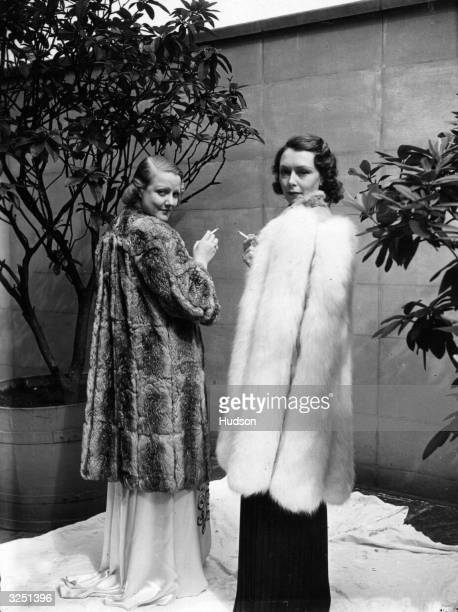 Two evening fur coats valued at 2000 guineas are modelled at the National Fur Fashion Parade at the Dorchester Hotel in London
