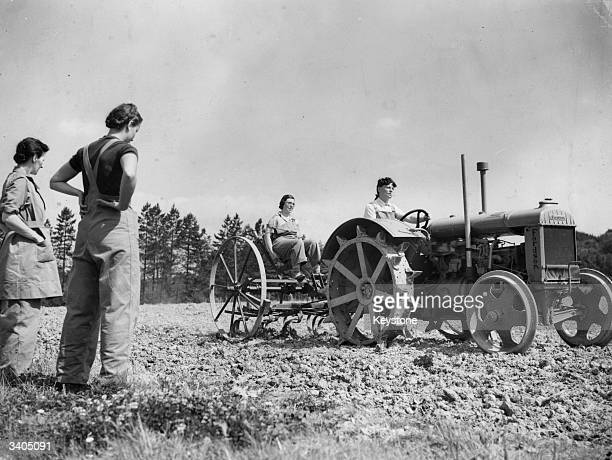 Recruits to the Women's Land Army learning to drive a tractor plough on a farm in Kent