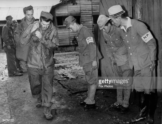 Former guards at the Ofuna prisonerofwar camp in Japan bid farewell to a group of liberated US Navy men with the customary bow at the end of World...