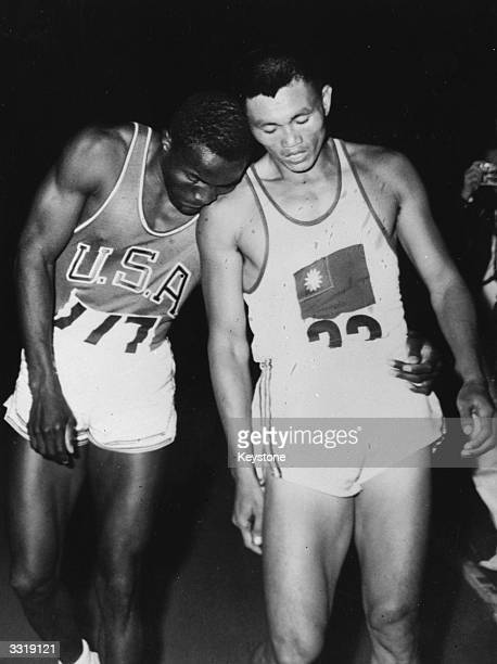 American athlete Rafer Johnson and Yang Chuan-Kwang of Taiwan together after completing the 1500 metres event of the decathlon at the 1960 Rome...