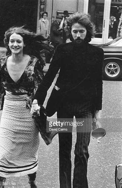 British singer and guitarist Eric Clapton of rock groups Blind Faith and Cream with his fiancee Alice OrmsbyGore daughter of Lord Harlech