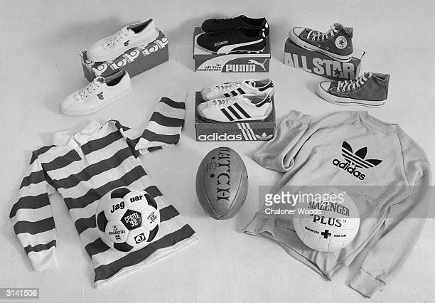 Football and rugger shirts and balls with trainers and sports shoes. Puma, Adidas, All Star are some of the brands.
