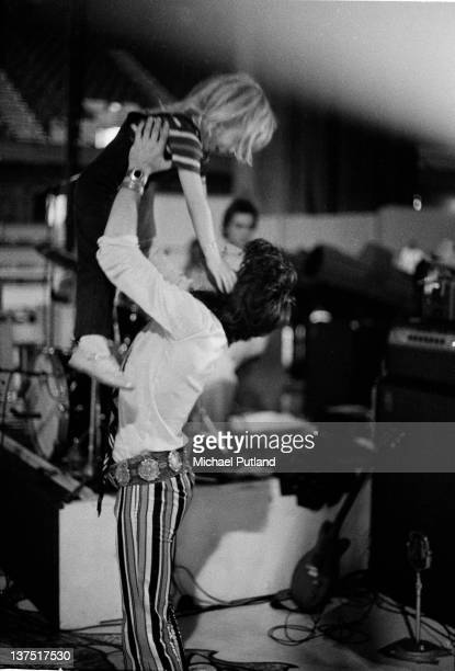 Keith Richards of the Rolling Stones holds his son Marlon in the air above him during a soundcheck at Wembley Empire Pool London 7th September 1973