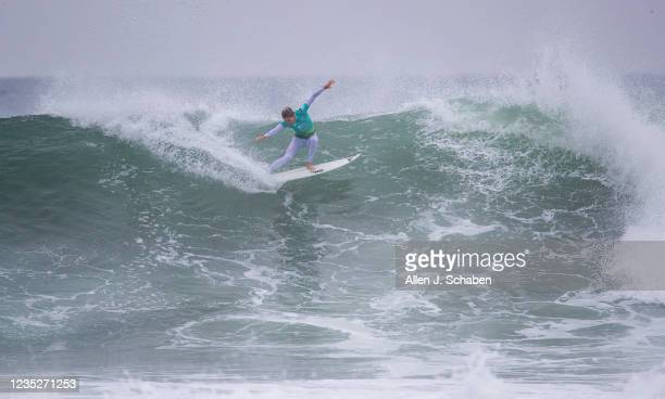 Time WSL champion Stephanie Gilmore of Australia, turns off the top of a big wave while competing against Johanne Defay of France, at the Rip Curl...