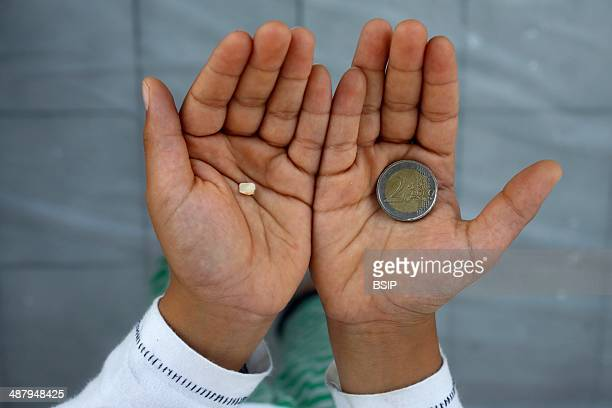7yearold boy showing a lost tooth and coin Montrouge France