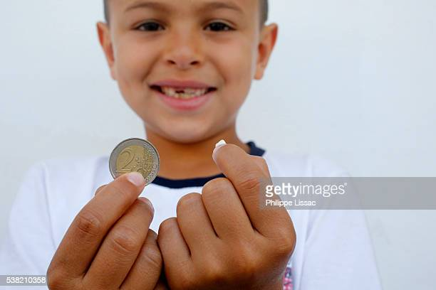 7-year-old boy showing a lost tooth and coin - tooth fairy stock pictures, royalty-free photos & images