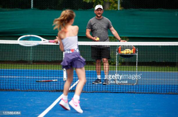 Year-old Saskia Brunskill, the photographer's daughter, in action during a social distancing tennis coaching session with Shaun Murray at Sale Sports...