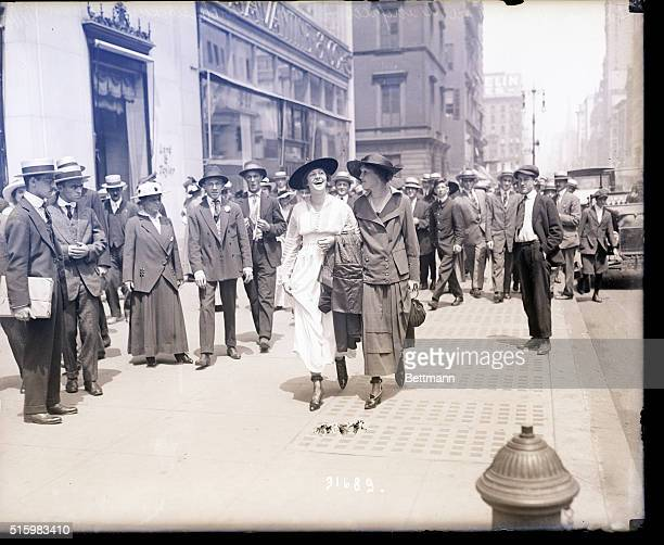 8/07/1915New York NY Miss Louise White and Miss Winifred Brown stroll past a group of onlookers on Fifth Avenue New York City outside Lord Taylor...