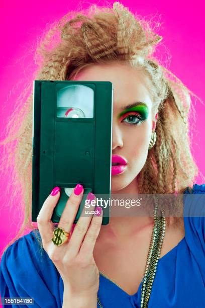 80s beautiful woman with video tape