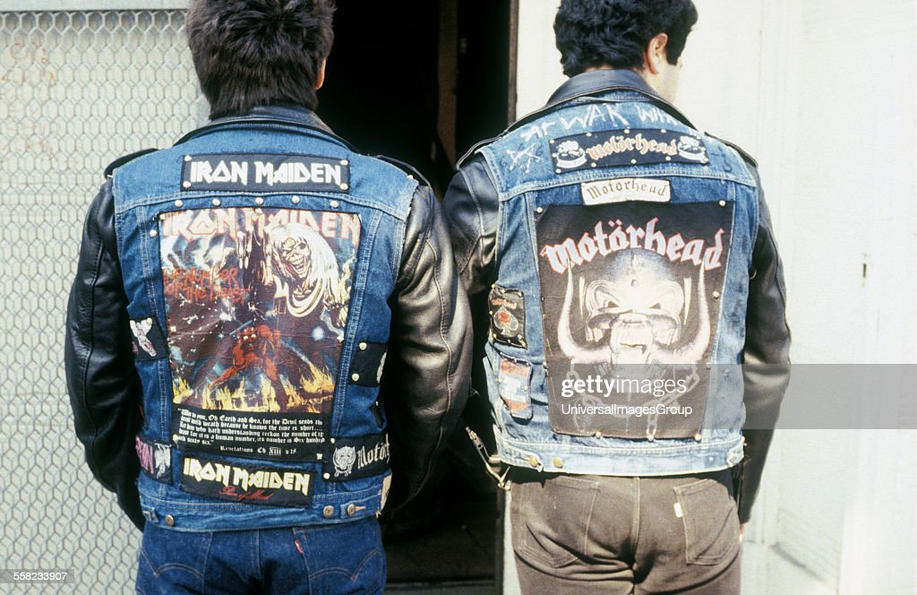 80s Heavy Metal fans wearing Iron Maiden and Motorhead leather jackets, Kings Road, London. 1980's : News Photo