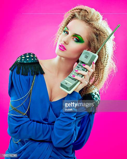 80s style girl with vintage phone