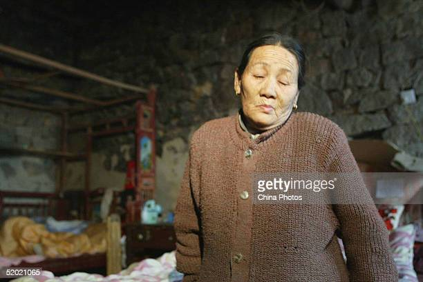 80yearold mother of Lin Bin one of the Chinese kidnapped in Iraq waits for the news of her son on January 19 2005 in Pingtan County of Fujian...