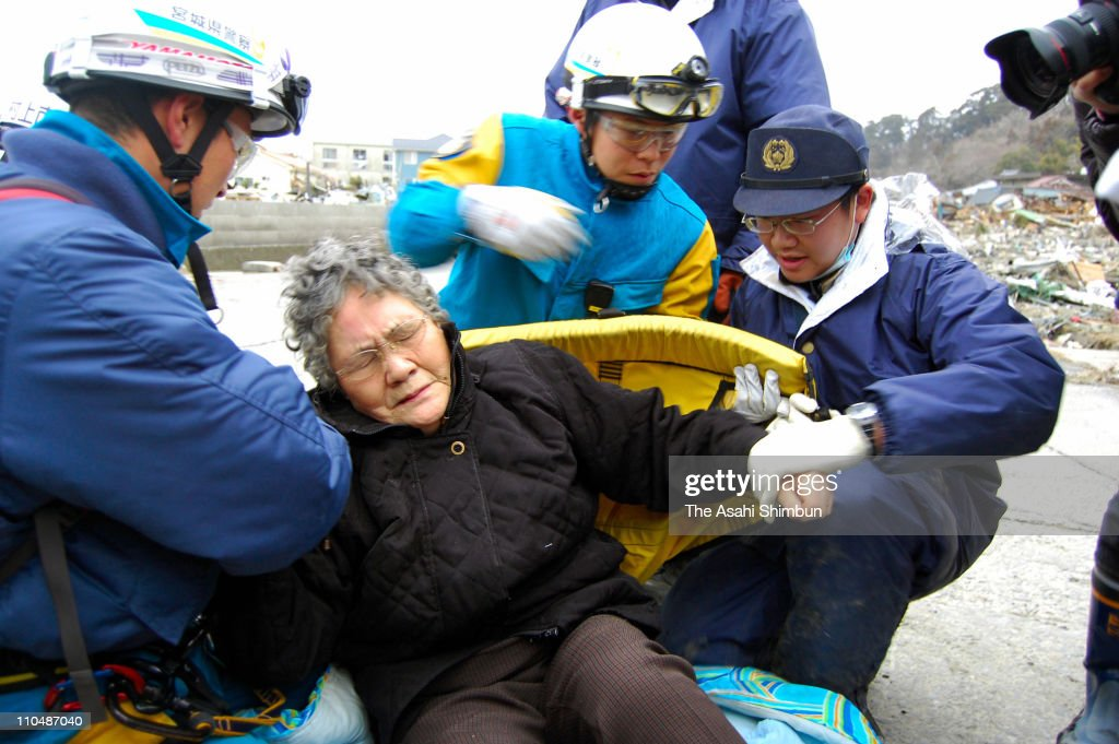 80-year-old Sumi Abe is rescued from her destroyed house 9 days after the 9.0 magnitude earthquake and tsunami on March 20, 2011 in Ishinomaki, Miyagi, Japan. The quake struck offshore on March 11, 2:46pm local time, triggering a tsunami wave of up to 10 metres which engulfed large parts of north-eastern Japan. The death toll continues to rise with fears that the official death count could well reach up to 10,000 in 'the most tragic event in Japanese history since World War Two'.
