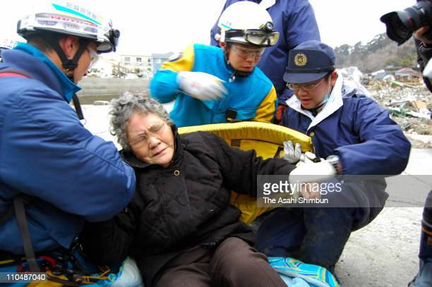 80yearold Sumi Abe is rescued from her destroyed house 9 days after the 90 magnitude earthquake and tsunami on March 20 2011 in Ishinomaki Miyagi...