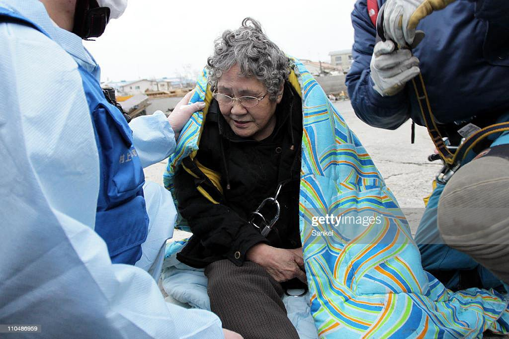 80-year-old Sumi Abe is rescued from her destroyed house nine days after the 9.0 magnitude earthquake and tsunami on March 20, 2011 in Ishinomaki, Miyagi, Japan. The quake struck offshore on March 11, 2:46pm local time, triggering a tsunami wave of up to 10 metres which engulfed large parts of north-eastern Japan. The death toll continues to rise with fears that the official death count could well reach up to 10,000 in 'the most tragic event in Japanese history since World War Two'.