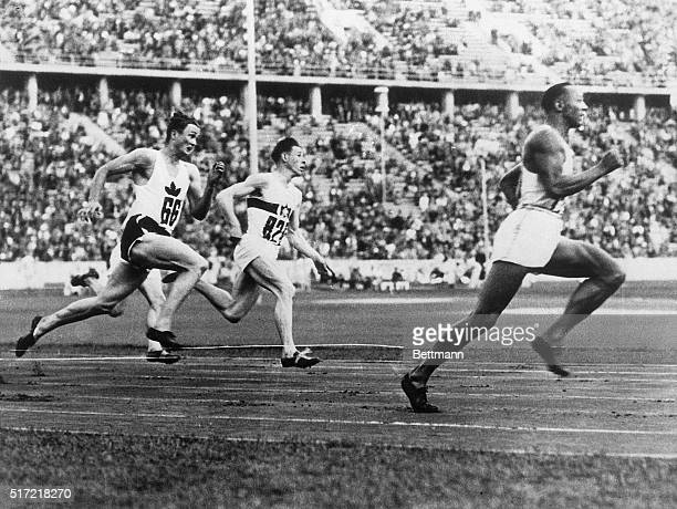 8/10/1936Berlin Germany Jesse Owens who won four events in the Olympic games is shown winning one of the 200meter heats L Orr of Canada is second and...