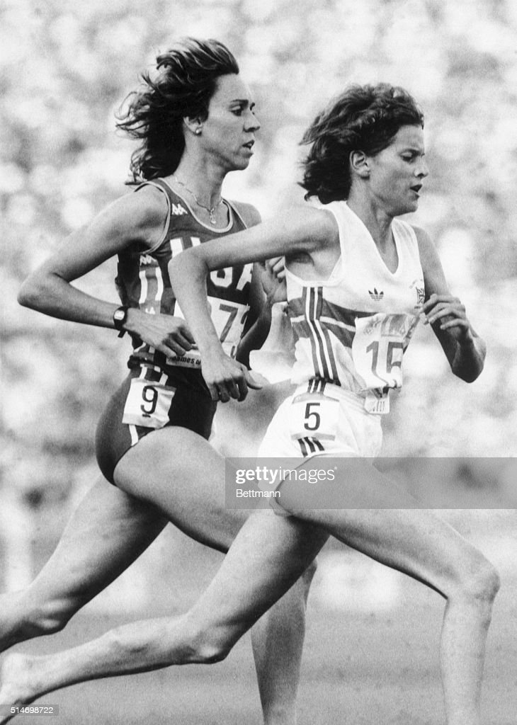 Zola Budd, leads America's Mary Decker by a small margin approximately one half lap before Decker was tripped and Budd was disqualified from the 300m race. Ph: Blake Sell