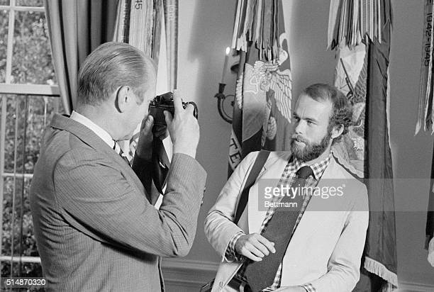 8/11/1974Washington DC After introducing his new personal photographer David Hume Kennerly at the White House President Gerald Ford took Kennerly's...