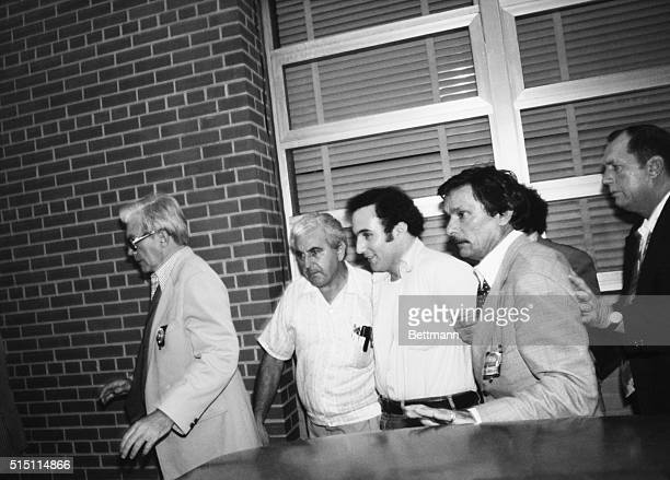 8/11/1977Brooklyn NY A smiling David Berkowitz is taken from a police car for booking prior to criminal court arraignment in connection with the Son...