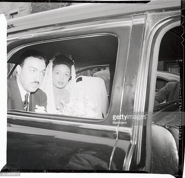 The Rev Adam Clayton Powell Jr New York Congressman from Harlem and Hazel Dorothy Scott colored night club pianist leave the Bethel African Church in...