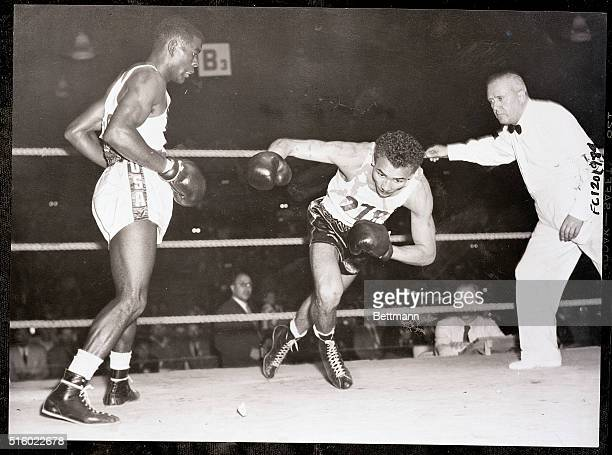 8/1/1952Helsinki Finland Solomon Carrizales Venezuela starts his trip to the canvas after absorbing some lusty pokes from Charley Adkins USA left in...