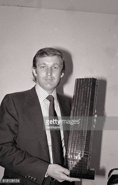 8/1/1980New York NY Donald Trump 33yearold golden boy of New York real estate holds a model of the Fifth Avenue tower that will have shops offices...