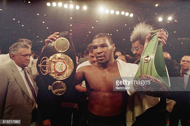 8/1/1987Las Vegas NVMike Tyson holds up the heavyweight belts for the WBA and WBC championships Tyson won a unanimous decision over Tony Tucker