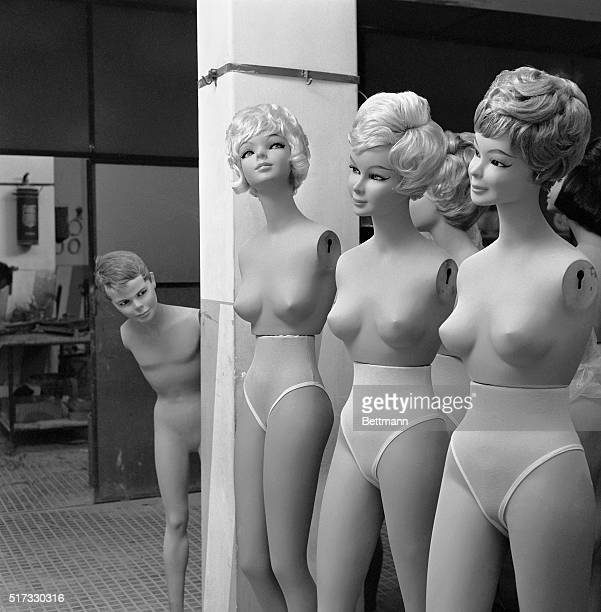 Rome Italy Taking a peek at a group of girl mannequins would be of interest to no one but a boy mannequin and this one is getting an eyeful He's just...