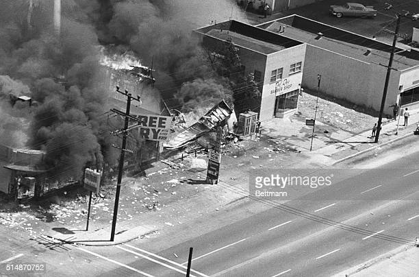 Los Angeles, CA: Three stores burn to the ground on Avalon Blvd. In the Watts area as the fire department was unable to get to the scene of the fire...