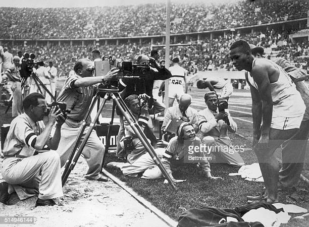 Nazi camera corps bombard a nonaryan Archie Williams of University of California a negro who won the Olympic 400 for the US was the lion of the hour...