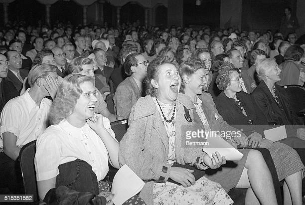 8/14/1946Berlin Germany A row of German women laugh heartily as they see Charlie Chaplin's imitation of Hitler making a speech in the movie 'The...