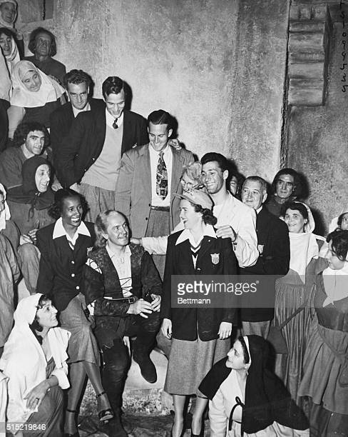8/14/1948London EnglandUS Olympic athletes had a merry day at a London film studio visiting American screen star Frederic March Shown are Anthony...